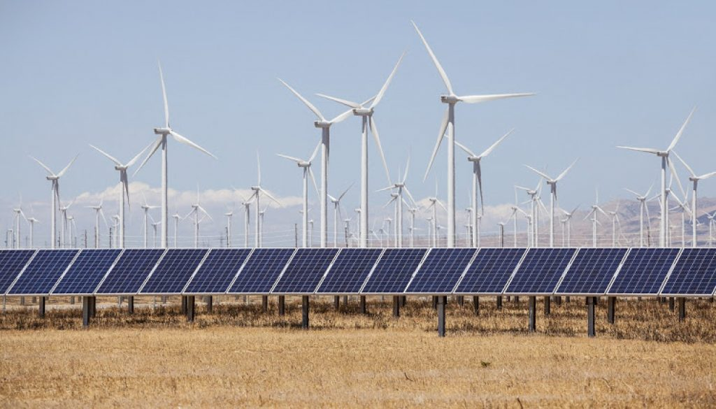 Wind mills and solar panels alternative energy production.