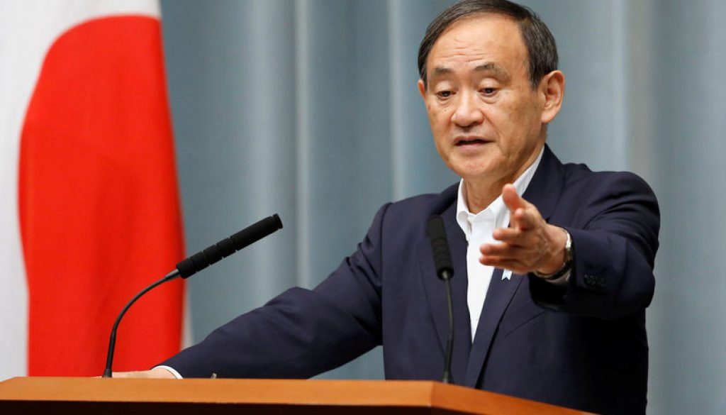 FILE PHOTO: Japan's Chief Cabinet Secretary Suga attends a news conference at Prime Minister Shinzo Abe's official residence in Tokyo