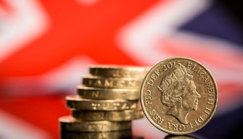 100572111_A_stack_of_British_one_pound_sterling_coins_stand_in_front_of_a_British_Union_flag_also_kn-xlarge_trans_NvBQzQNjv4BqgsaO8O78rhmZrDxTlQBjdEbgHFEZVI1Pljic_pW9c90