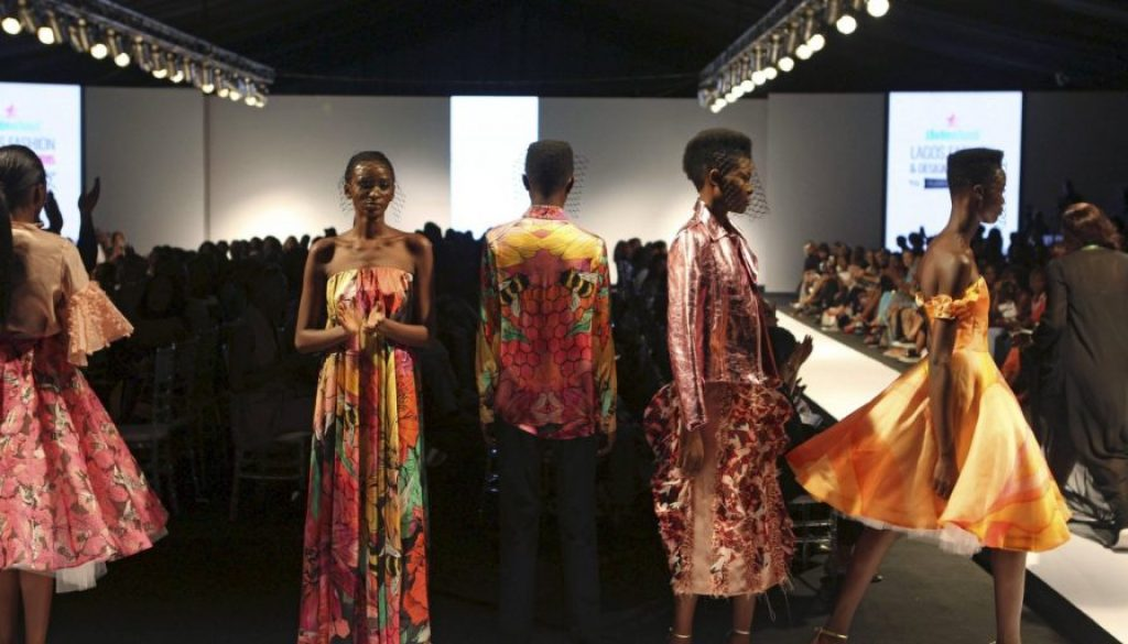 Models wearing clothes by design Onalaja pose on the runway during Lagos Fashion and Design Week in Lagos