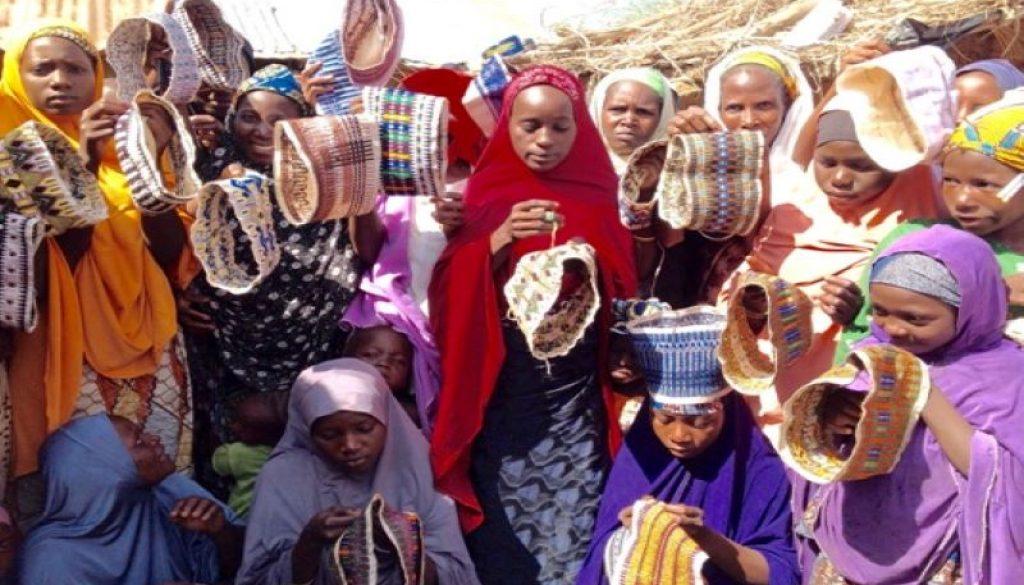 Young women weaving caps